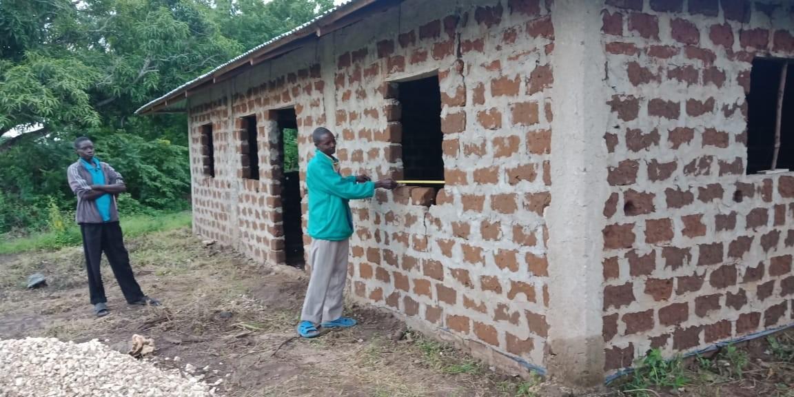 Jane Wambui,receives a house